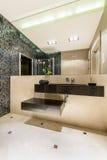 Large portion of avantgarde in modern bathroom's decor Royalty Free Stock Image