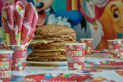 A large portion of pancakes on the festive table of the children`s birthday stock photos