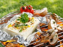 Halloumi or feta cheese on a barbecue Royalty Free Stock Image