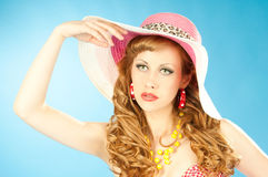 A large portrait of a cute red-haired girl in the pink sun hat Stock Photo