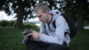 A Large Portrait Of A Man With A Professional SLR Camera In Hand stock footage