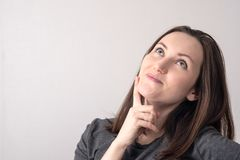 Large portrait of young woman with a dreamy look. place for text stock photos