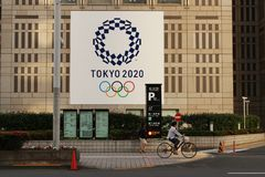 A large poster sporting the logo of the 2020 Tokyo Olympics on Tokyo City Hall Stock Photography