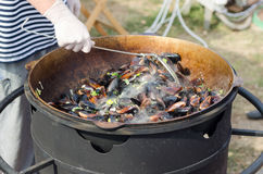 Large Pot of Hot Steaming Mussels Cooking Outdoors Royalty Free Stock Photo