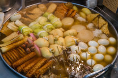 Large pot of oden, a Japanese winter dish. Hot oden with daikon radish, boiled eggs, sausages, cabbage wraps, and more Royalty Free Stock Photo