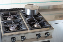 Large pot over the stove of industrial kitchen Royalty Free Stock Photography