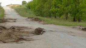 Large potholes in a dirt road. Dug by huge wheels of trucks stock video
