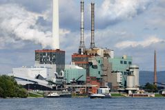 Large power plant beside a river Royalty Free Stock Photos