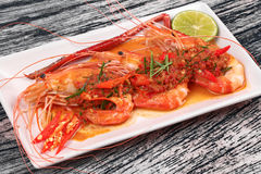 Large prawn topped spicy coconut cream curry. Stock Image