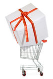 Large present in small shopping cart Royalty Free Stock Photography