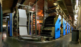 Large printing press. A view of a large, modern newspaper printing press stock photos