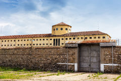 Large prison area with a tall watchtower Stock Images