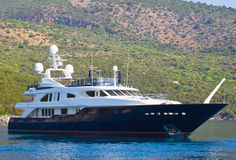 A large private motor yacht at sea. At sea a large luxury private motor yacht Stock Photo