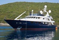 A large private motor yacht at sea. At sea a large luxury private motor yacht Stock Image