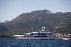 A large private motor yacht under way out at sea Stock Photography
