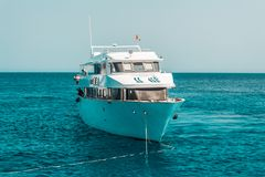 A large private motor yacht under way sailing out on tropical sea. royalty free stock photos