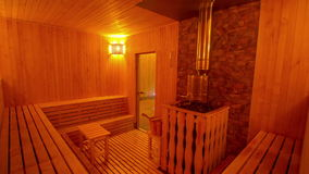 Large private sauna with a stylish interior_3. The interior of a large private sauna, taken from camera dolly