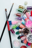 Large professional set. Of paints and glitter for manicure on the table Royalty Free Stock Photos
