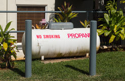 Large propane tank in landscaped garden Stock Image