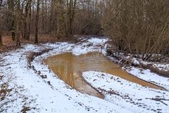 Large puddle on the rural road. Large puddle on the rural road in the early spring Royalty Free Stock Photo