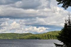 Large Puffy Clouds Over A Lake in Ontario`s Cottage Country. Clouds dominate the sky over beautiful Lake Haliburton , located just south of Algonquin Park in stock photography