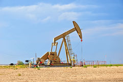 Large Pump Jack Pulling Crude Oil Up Stock Photography
