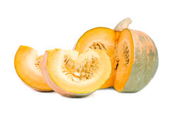 Large pumpkin with slices. Royalty Free Stock Photography