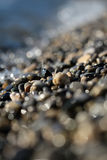 Large quantities of wet pebbles Royalty Free Stock Images