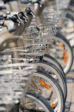 In large quantity. Large quantity of bicycles on the Parisian street Stock Image