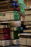 Large quantity of wooden plywood stored in warehouse Royalty Free Stock Photo