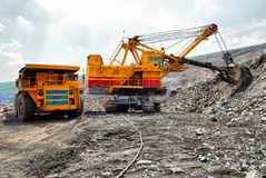 Large quarry dump truck. Loading the rock in the dumper. Loading Stock Photography