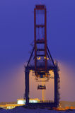 Large quay crane at night. Backlit container crane in the Port of Rotterdam against blue night sky Royalty Free Stock Images