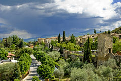 A large rain cloud looming over the city of San Quirico d 'Orcia Royalty Free Stock Photography