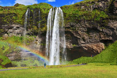 Large rainbow decorates a drop of water Royalty Free Stock Photo