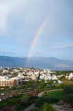 Large rainbow over city Stock Image