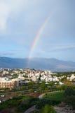 Large rainbow over city Stock Image