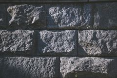 Large raised stone with a shadow. Vintage background Royalty Free Stock Photo