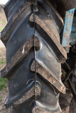 Large rear tire of an old tractor closeup Royalty Free Stock Images