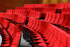 Large recliners stand rows in an empty hall Royalty Free Stock Image
