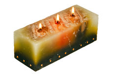 Large Rectangular Candle with Three Lighted Wicks Royalty Free Stock Photography