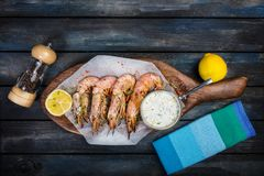 Large red Argentine shrimp or langoustine with white sauce and lemon. royalty free stock photo