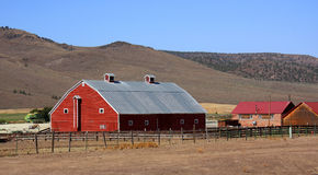 A large red barn. Large barn on the way to the Dalles from Madras Oregon on hwy. 97N Royalty Free Stock Image