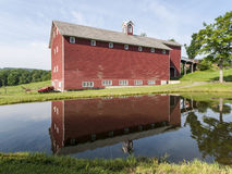Large Red Barn Reflected in Pond Royalty Free Stock Image