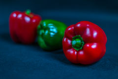 Large red bell pepper against other peppers, red and green peppe Royalty Free Stock Photo