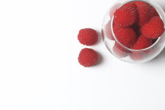 Large red berries are similar to raspberries in a glass vase. Royalty Free Stock Photos