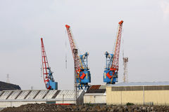 Large red and blue cranes. Swansea docks stock image