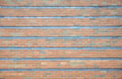 Large red brick wall background with darker grey stripes. Background royalty free stock photography