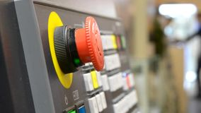 Large red button on the control panel. Industrial machine close-up stock footage