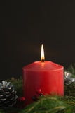 Large red candle burning bright Stock Photos