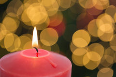 Large red candle burning bright Royalty Free Stock Photos